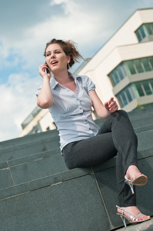 Young beautiful smiling woman calling with mobile phone photo