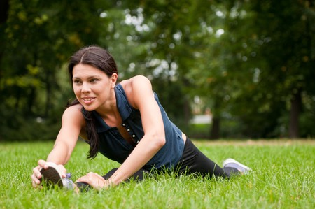 Woman performs stretching before sport in park Stock Photo - 7807753