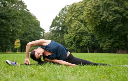 Woman stretching muscles before jogging photo