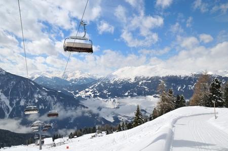 Empty ski lift in beautiful winter snowy mountain landscape (resort in Alps) photo