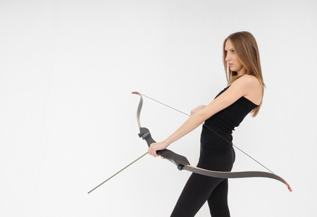 Beautiful woman aiming with bow and arrow Stock Photo - 8095160