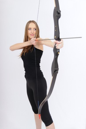 Beautiful woman aiming with bow and arrow Stock Photo - 8095153