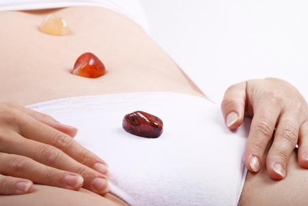 harmonize: Alternative medicine - healing by semiprecious gems placed on body chakras, shallow depth of field