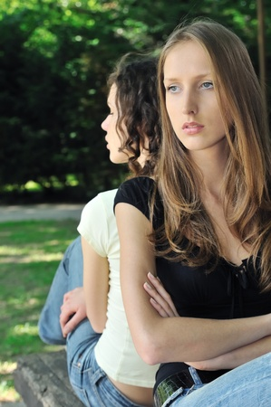 Friends outdoors series - two teenage girls are in conflick and do not speak with each another Stock Photo - 8577512