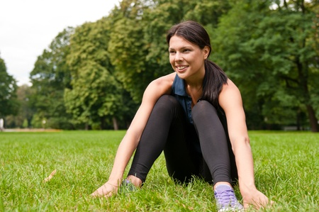 Relax - sportswoman sitting in grass Stock Photo - 8602279