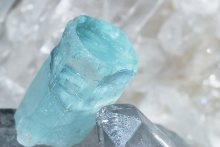 Aquamarine gem energized on druze of quartz crystals. This gem is used as a jewel stone and also in alternative medicine and esoterics.