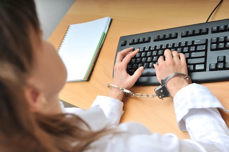 woman handcuffs: Business person tied with handcuffs