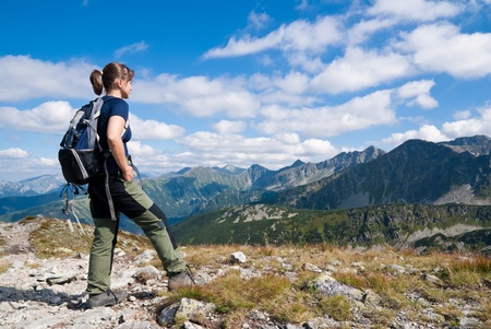 Hiking young person in mountains - relax scene photo