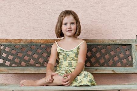 Outdoors portrait of small cute child -natural expression photo