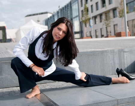 warm up exercise: Stretching - woman exercising outside