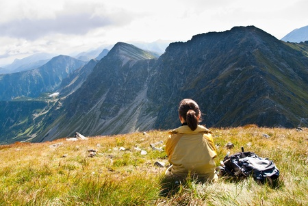 views of the mountains: Young person relaxes on hiking in mountains (East Tatras, Slovakia, central Europe)