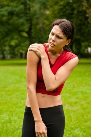 Shoulder injury - sportswoman in pain photo