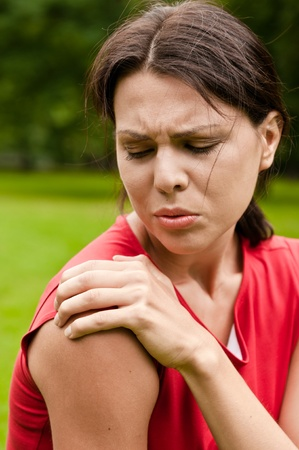 aching muscles: Shoulder injury - sportswoman in pain