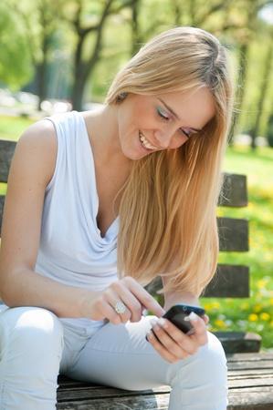 Mobile communication - smiling teenager photo