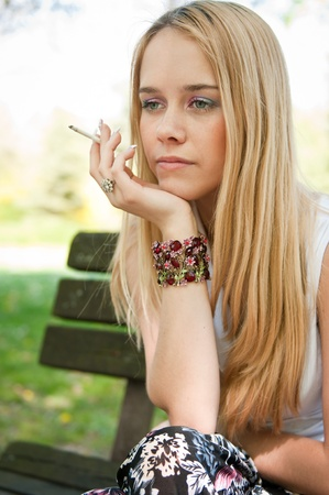 Problems - teenager smoking cigarette Stock Photo - 9461707