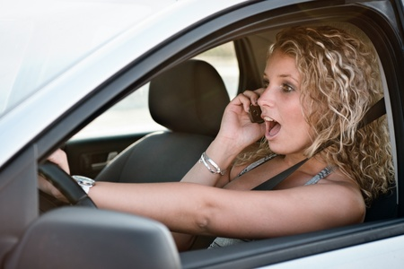 Calling mobile phone while driving car photo