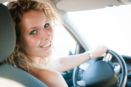 rear wheel: Portrait of young smiling woman inside a car