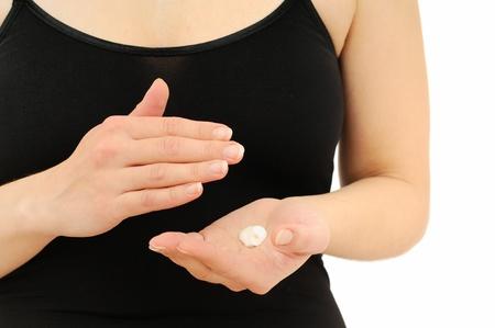Woman in underwear applies cream on dry hands  photo
