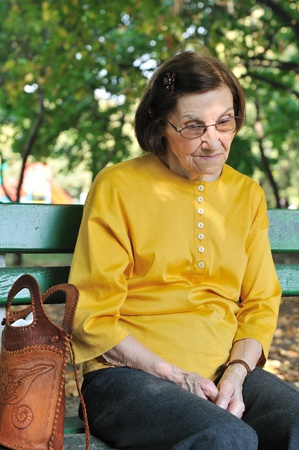 lonely person: Outdoors portrait of lonely and worried senior woman               Stock Photo