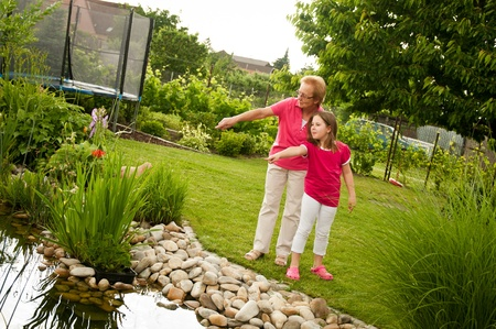 children pond: Happy time with grandchild