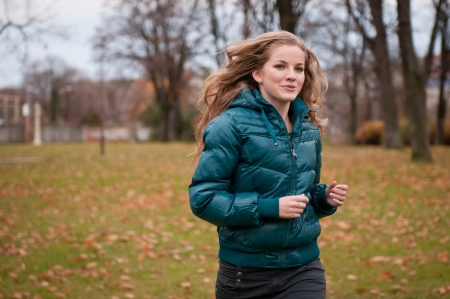 Autumn jogging - young woman Stock Photo - 10173430