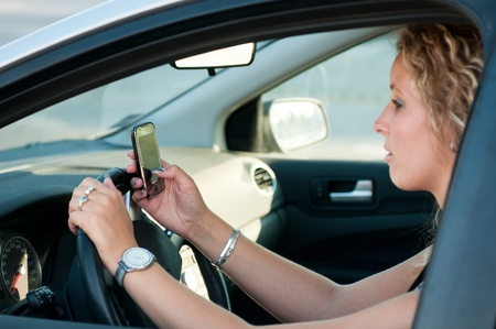 Reading SMS while driving car photo