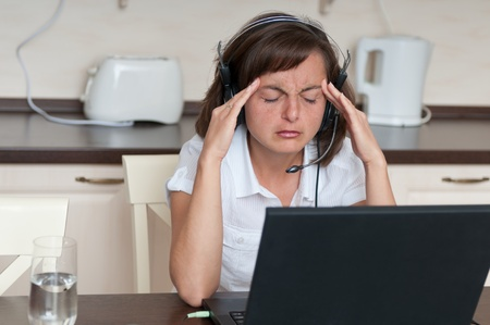 Business woman with headache Stock Photo - 10711471