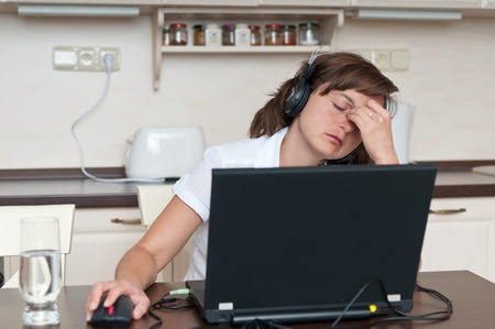 Business woman with headache Stock Photo - 10711397