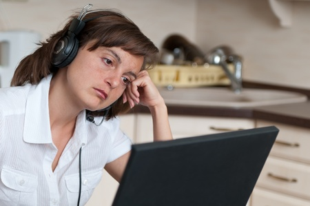 unmotivated: Bored and tired business woman working at home Stock Photo