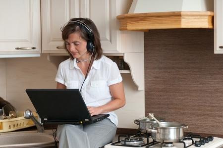 Multitasking - preparing meal and working Stock Photo - 10711424