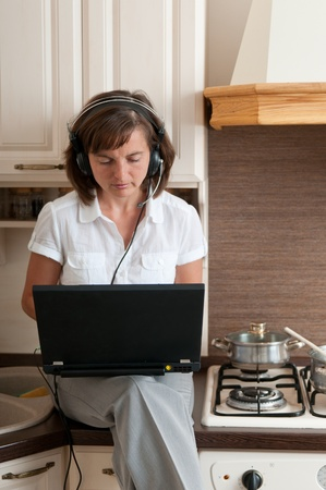 Mobility concept - business person having work conference call from home while cooking photo