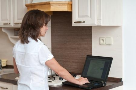 Multitasking - preparing meal and working photo