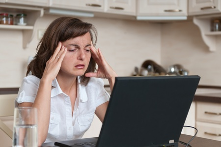 Business person with headache in work Stock Photo - 10711465