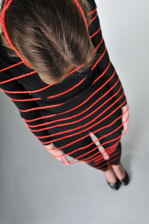 tied in: Tied - young woman in ropes Stock Photo