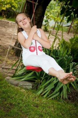 Child swinging on seesaw photo