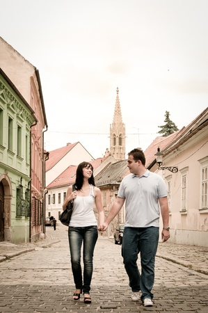 slovakia: Young couple walking in old town of Bratislava (capital of Slovakia)