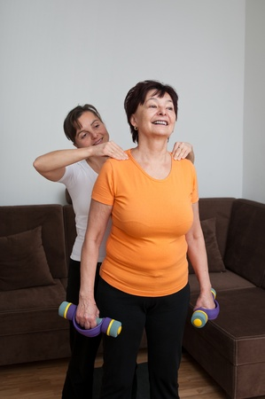 Senior fitness woman receiving massage photo