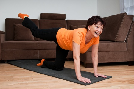 elderly exercise: Senior woman exercising at home