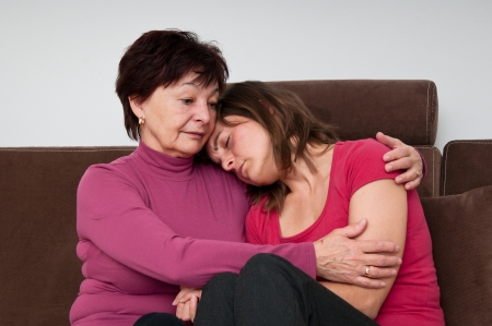 regret: Big troubles - senior mother comforts daughter Stock Photo