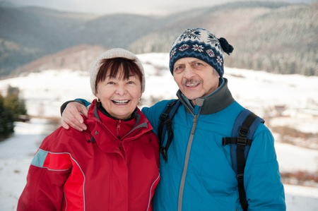embracement: Portrait of senior retired couple in winter