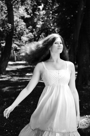 BW portrait of young woman with fairy look - outdoors in park photo