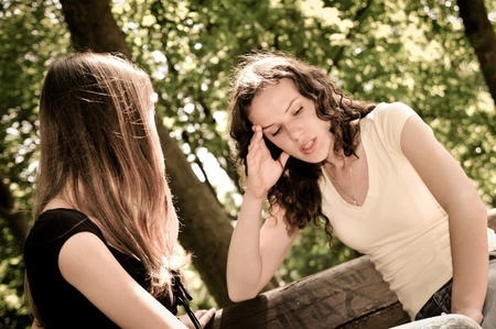 Friends series - one teenage girl comforts another which has serious problem Stock Photo - 12082843
