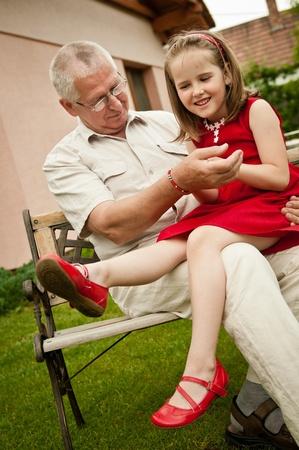 Happy retirement - grandparent with grandchild Stock Photo - 12082857