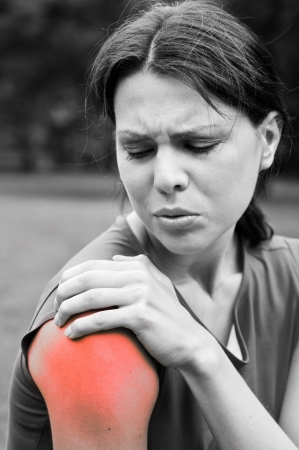 muscle tension tense: Shoulder injury - sportswoman in pain