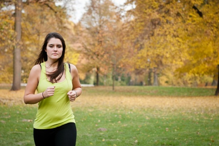 Young person jogging outdoor in nature Stock Photo - 12082850