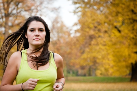 Young person jogging outdoor in nature Stock Photo - 12082836