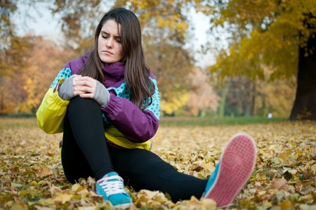 painful: Knee injury - woman sitting in pain Stock Photo