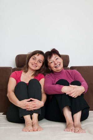 Love - mother and daughter at home photo