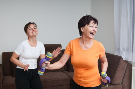woman dancing: Senior and young fitness woman dancing Stock Photo