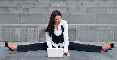 Flexible business - woman with laptop photo